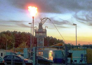 Flaring during workover of a gas well.