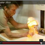 A man burning tap water in a kitchen sink