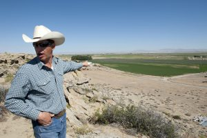 Figure 1- John Fenton points to Pavillion farms and gas development sites