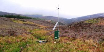 A water monitoring station at a small creek in a foggy valley